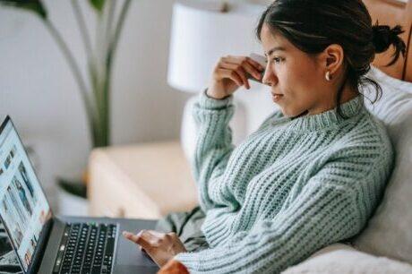 asian woman reading online blogs about viosapp vios app telemedicine Telehealth digital health