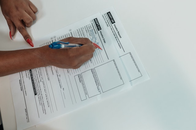 woman completing a healthcare coverage form for pap smear tests covered by medicare in usa
